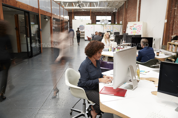 Business Team Working At Desks In Modern Open Plan Office - Stock Photo - Images