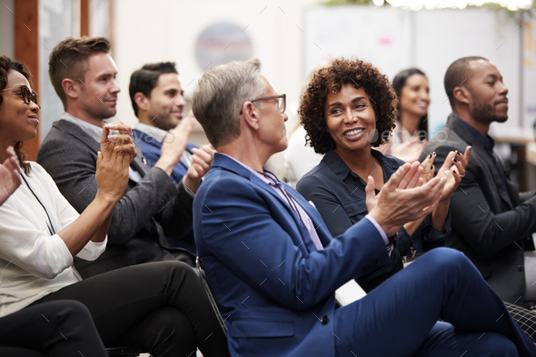 Group Of Businessmen And Businesswomen Applauding Presentation At Conference - Stock Photo - Images