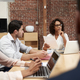 Businesswoman Leading Office Meeting Of Colleagues Sitting Around Table - PhotoDune Item for Sale
