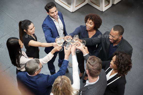 Overhead Shot Of Business Team Celebrating Success With Champagne Toast In Modern Office - Stock Photo - Images
