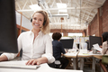 Portrait Of Female Customer Services Agent Working At Desk In Call Center - PhotoDune Item for Sale