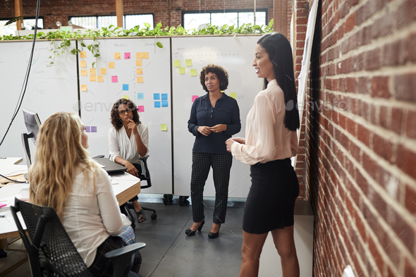 Female Creative Team Meeting To Discuss Ideas In Modern Office - Stock Photo - Images