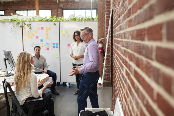 Creative Team Meeting To Discuss Ideas In Modern Office - Stock Photo - Images