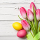 Fresh pink tulips and easter eggs on wooden background - PhotoDune Item for Sale
