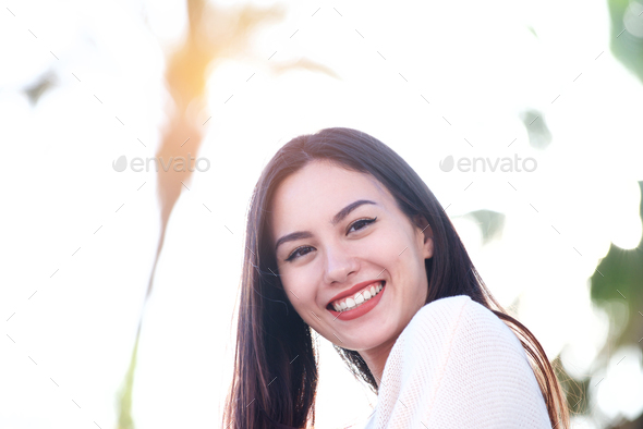 Close up of beautiful friendly woman smiling outside - Stock Photo - Images