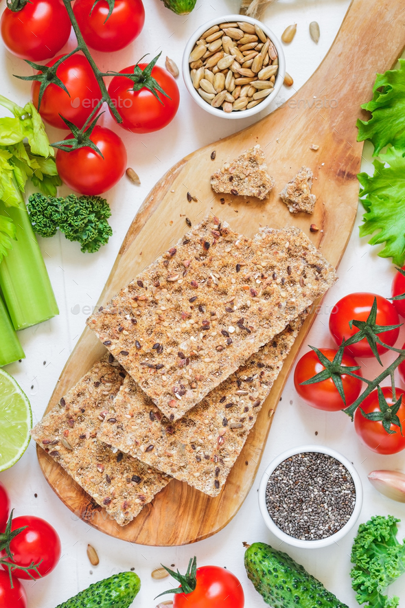 Rye crispbreads and vegetables - Stock Photo - Images