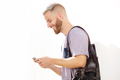 cool young guy with beard looking at mobile phone - PhotoDune Item for Sale