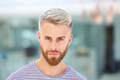 Close up handsome young man with beard staring - PhotoDune Item for Sale