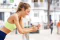 healthy young woman listening to music on mobile phone - PhotoDune Item for Sale