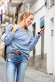 happy young woman walking in city with cell phone - PhotoDune Item for Sale