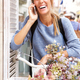 cheerful young woman talking on mobile phone - PhotoDune Item for Sale