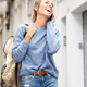 happy woman walking in city and talking on mobile phone - PhotoDune Item for Sale