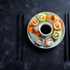 Various Fresh and delicious sushi set on ceramic plate with slate sticks, sauce on black stone - PhotoDune Item for Sale