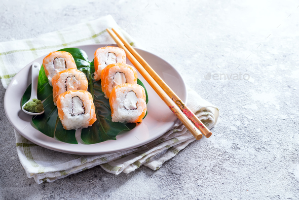 Philadelphia roll classic on a plate with chopsticks. Japanese sushi food. Copy space - Stock Photo - Images
