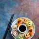Various Fresh and delicious sushi set on ceramic plate with slate sticks, sauce on stone background - PhotoDune Item for Sale