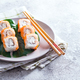 Philadelphia roll classic on a plate with chopsticks. Japanese sushi food. Copy space - PhotoDune Item for Sale