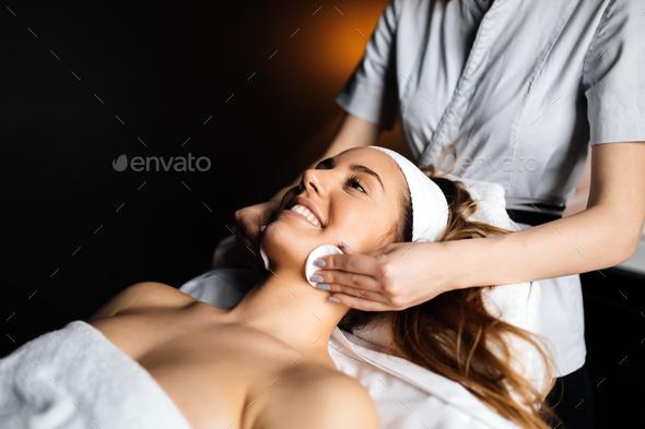 Lovely brunette enjoying massage - Stock Photo - Images
