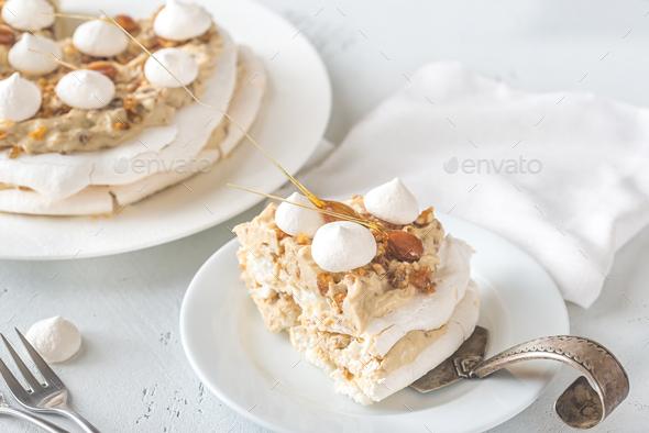 Pavlova cake with caramel and almonds - Stock Photo - Images