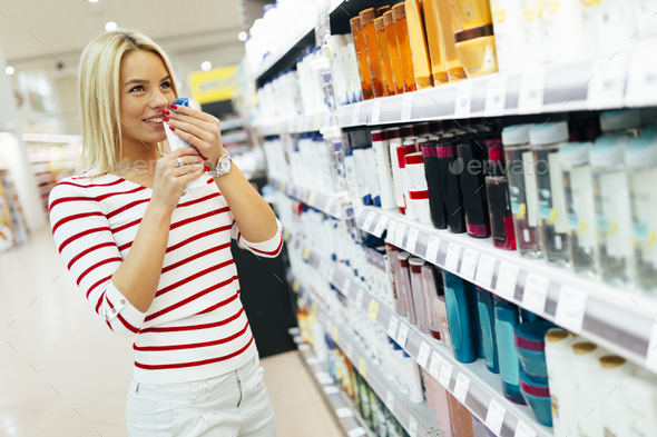 Beautiful woman buying body care products - Stock Photo - Images