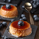 two homemade egg custards with cranberries on a black stone tray - PhotoDune Item for Sale