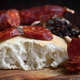 chorizo wheels on wood with knife bread and garlic - PhotoDune Item for Sale