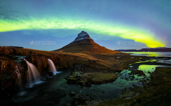 Northern light (Aurora Borealis) over Kirkjufell mountain in iceland - Stock Photo - Images