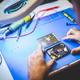 Worker fixing HDD disc in workshop. - PhotoDune Item for Sale