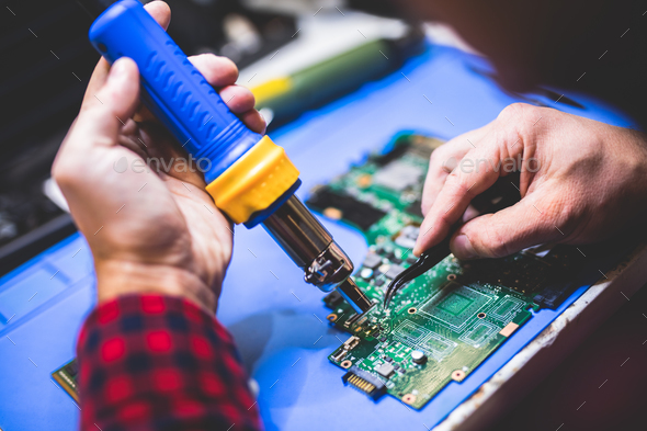 Man fixing main board of a computer. - Stock Photo - Images
