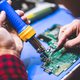 Man fixing main board of a computer. - PhotoDune Item for Sale