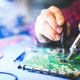 Worker fixing a main board of a computer. - PhotoDune Item for Sale