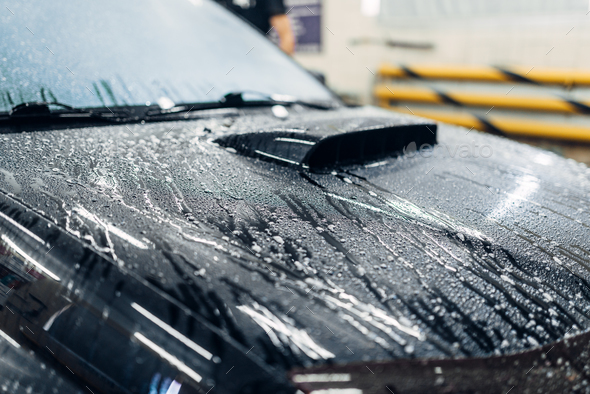 Carwash service, car covered with foam - Stock Photo - Images