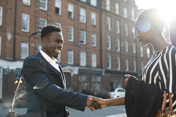 New business acquaintances shaking hands - Stock Photo - Images