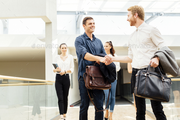 Businessmen shaking hands - Stock Photo - Images