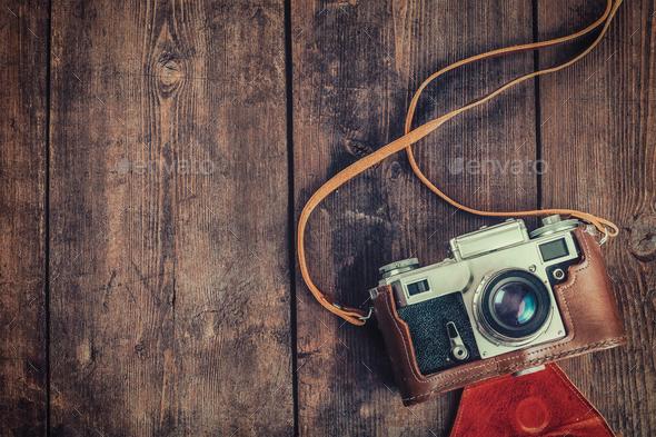 Old retro vintage camera on grunge wooden background - Stock Photo - Images
