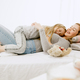 Young mother and her little daughter hugging and kissing on bed - PhotoDune Item for Sale