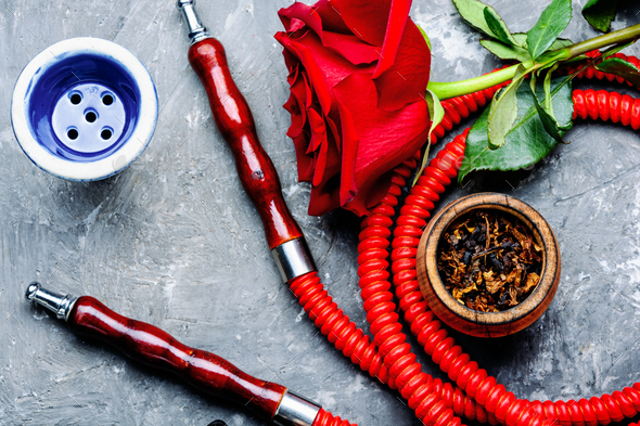Smoking hookah with rose flavor - Stock Photo - Images