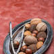 Hazelnut, walnut, almond and brazil nuts on plate with nut cracker, vertical, copy space - PhotoDune Item for Sale