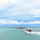 Speed boat is leaving the coast of Tarutao island - PhotoDune Item for Sale