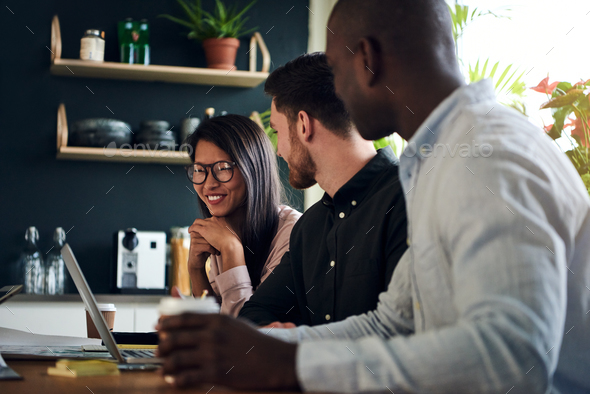Diverse group of smiling colleagues working together in an office - Stock Photo - Images