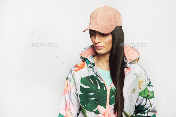 Pretty girl in fashionable jacket and pink cap - Stock Photo - Images