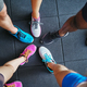 Diverse people wearing running shoes standing in a gym - PhotoDune Item for Sale