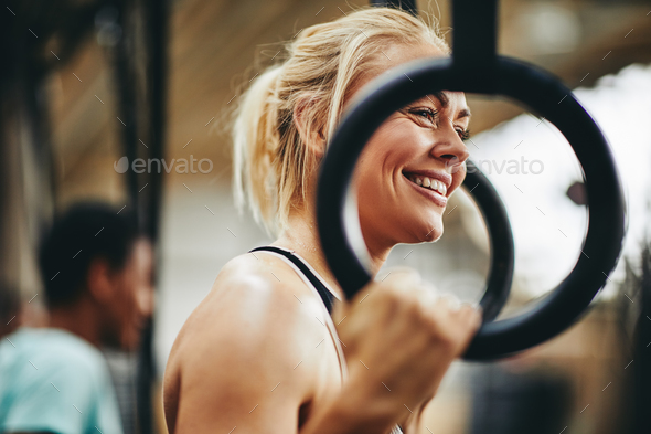 Fit woman preparing to workout with rings at the gym - Stock Photo - Images