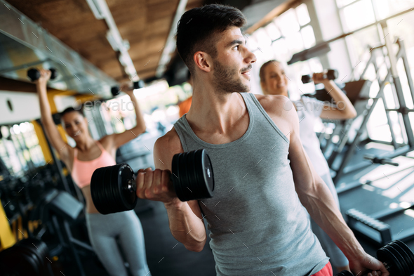 Determined male working out in gym - Stock Photo - Images