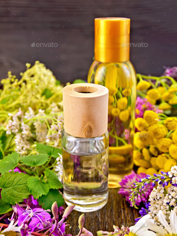 Oil and lotion with flowers on board - Stock Photo - Images
