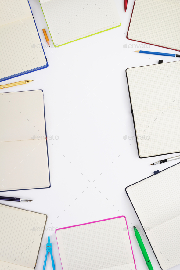 paper notebook and school supplies at white - Stock Photo - Images