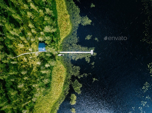 Aerial view of blue lake with green forests in Finland.  - Stock Photo - Images