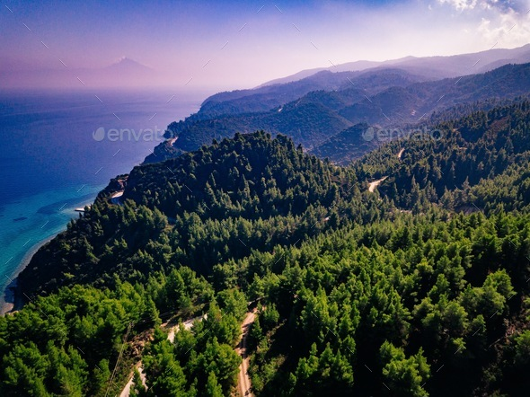 Aerial view overhand the green mountain forest and sea in Greece - Stock Photo - Images