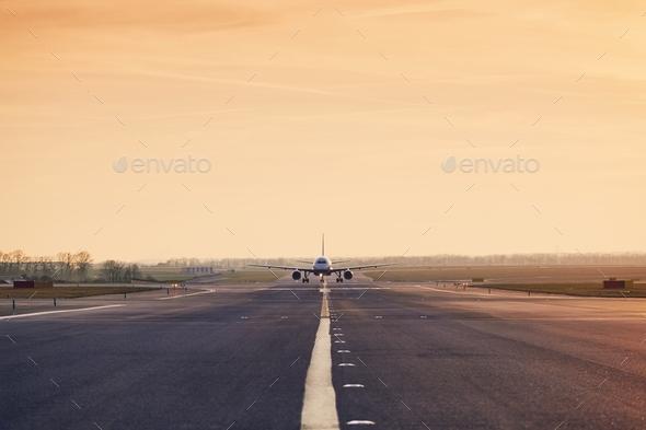 Traffic at airpot at sunset - Stock Photo - Images