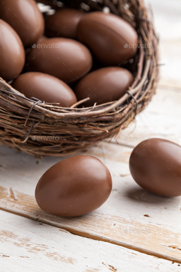 Chocolate Easter holiday egg on rustic backround - Stock Photo - Images
