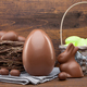 Chocolate Easter holiday egg on rustic backround - PhotoDune Item for Sale
